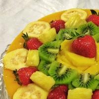 Mousse y geleé de mango con frutas tropicales